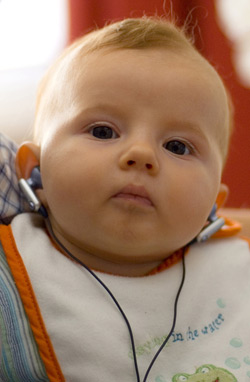 a baby wearing earbuds